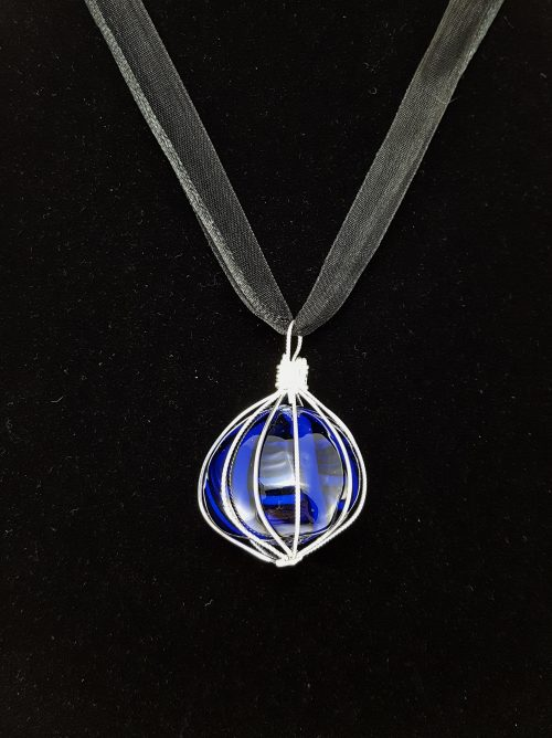 Cobalt blue glass bauble pendant wrapped in silver-filled wire. Extraversions pendants come with a free ribbon cord (as pictured). Black faux-leather cords, copper-toned chains, and light sterling silver chains are available for purchase as well.