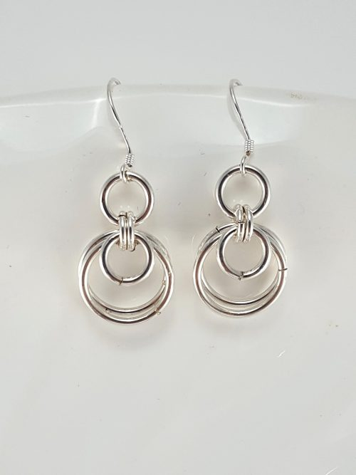 These loop-in-loop earrings are made of handmade silver-filled wire jump rings, and the earwires are sterling silver.