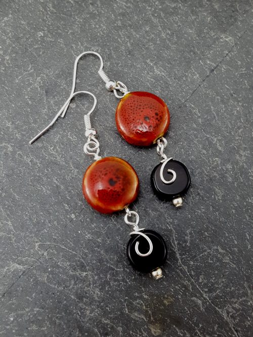 red and black earrings with wire flow